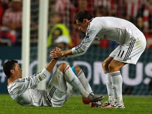 Real's Cristiano Ronaldo, left,  is helped by team-mate Gareth Bale