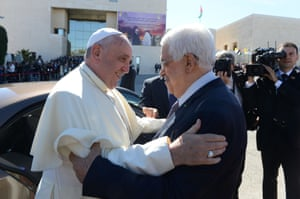 """Palestinian President Mahmoud Abbas greets Pope Francis in Ramallah, West Bank. Pope Francis addressed the Israeli-Palestinian conflict as """"unacceptable"""" and urged both sides to find courage in seeking a peaceful solution."""