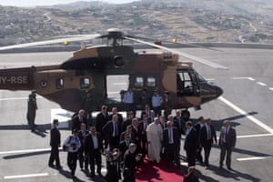 Pope Francis disembarks from a Jordanian military helicopter as he arrives in Bethlehem on 25 May on the most sensitive part of his three day tour