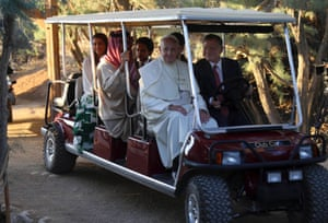 Pope Francis is driven by King Abdullah in a golf cart to the site at the Jordan River where Jesus is believed to have been baptised.