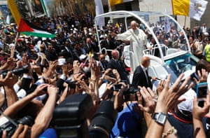 Pope Francis waves to the crowds at Manger Square. He invited the Israeli and Palestinian presidents to come to the Vatican to pray for peace a month after US-backed talks aimed at ending the Middle East conflict collapsed.