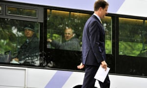 Nick Clegg walks past a bus stop to cast his vote at the Hall Park Centre, Sheffield last Thursday.