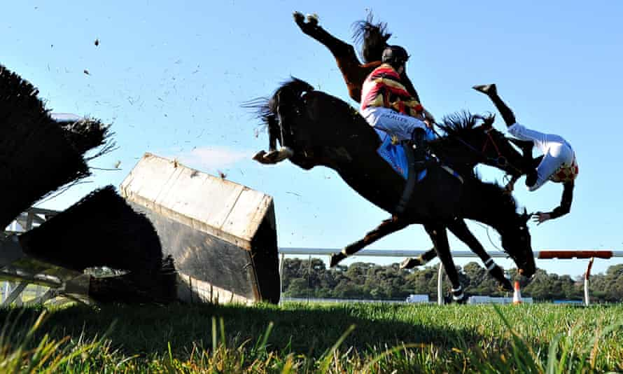 Martin Kelly riding Show Dancer crashes through the steeple jump and falls to the ground.
