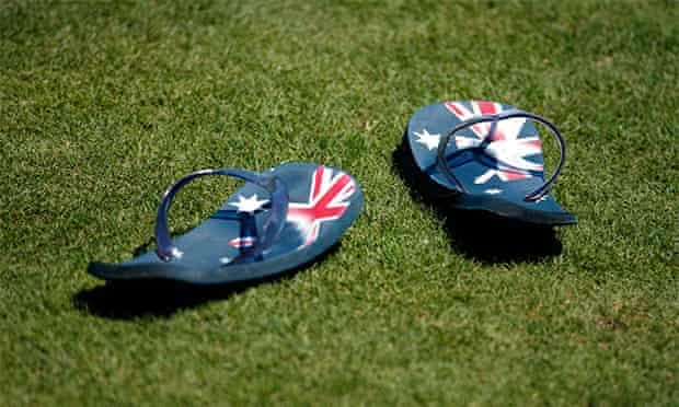 Thongs with Australian flags sit on the field