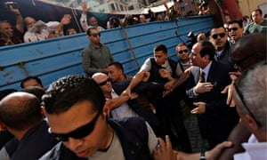 Presidential candidate Abdel Fatah al-Sisi arrives at a Cairo polling station to vote