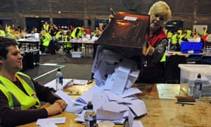 A ballot box is emptied on to a counting table at the Edinburgh count in the European elections.