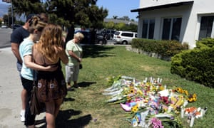 People pay their respects at a make-shift memorial set up outside the Alpha Phi sorority where two women died during the shooting at the college town of Isla Vista, California on 25 May.
