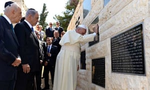 Pope Francis places his hands on a plaque at the Memorial to Victims of Terror in Jerusale