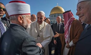 Pope Francis greets the Mufti of Jerusalem Muhammad Ahmad Hussein (left) at the Dome of the Rock