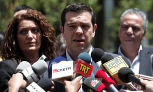 Syriza leader Alexis Tsipras speaks to the media after his meeting with Greek President Karolos Papoulias on Monday.