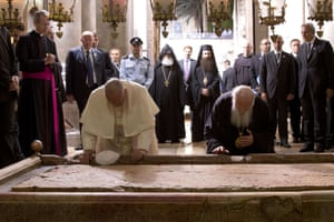 Pope Francisand Ecumenical Patriarch of Constantinople Bartholomew I pray over the Stone of Unction at the Church of the Holy Sepulchre in Jerusalem's Old City.