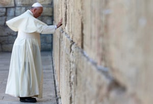 Pope Francis touches the stones of the Western Wall, Judaism's holiest prayer site, in Jerusalem's Old City.