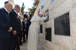 Israeli President Shimon Peres and Prime Minister Benjamin Netanyahu accompany Pope Francis as he visits the memorial monument commemorating victims of terrorist acts on Mount Herzl.