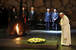 Pope Francis prays after laying a wreath during a memorial ceremony in the Hall of Remembrances  in the Yad Vashem Holocaust memorial.