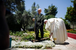 Pope Francis and Israel's President Shimon Peres plant an olive tree after their meeting at the president's residence in Jerusalem