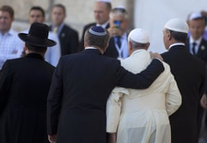 Pope Francis, Rabbi Abraham Skorka (second left) and the Rabbi of the Western Wall Shmuel Rabinovitz (left) leave the Western Wall compound.