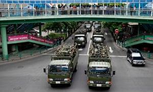 Chinese paramilitary police travel through Urumqi, Xinjiang