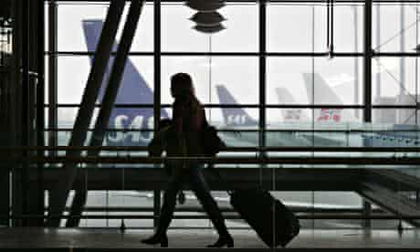 Woman and case at an airport