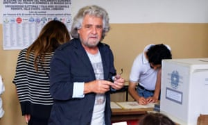 Beppe Grillo, leader of Five Star Movement (M5s), casting his ballot at a polling station in Italy yesterday.