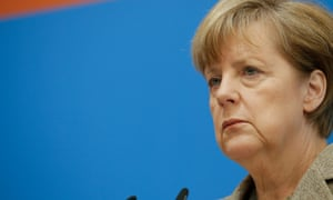 Angela Merkel holding a news conference following the European election results.