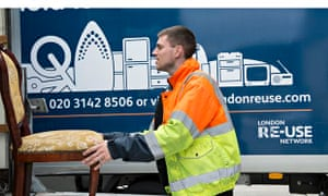 Re-use: man loading chair on lorry