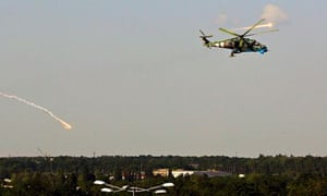 A Ukrainian helicopter gunship fires decoy flares after attacking Donetsk international airport