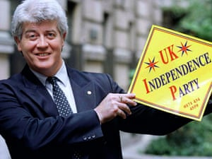 Alan Sked holds aloft the logo of the UK Independence Party in the early 1990s.