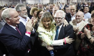 Martina Anderson, centre, celebrates with her husband Paul as well as Sinn Fein's Martin McGuinness and Gerry Adams after she topped the poll in Northern Ireland's European elections.