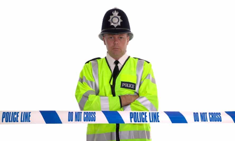 Policeman behind police tape