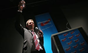 Bernd Lucke, head of the new Alternative for Germany (AfD) party, raises his glass to supporters on Sunday celebrating its capture of seven percent of the vote in Germany's European elections.