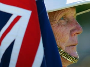 A war veteran of the British Royal Marines marches in the parade for Anzac Day.