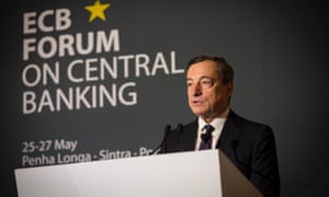 A handout picture taken and released on May 26, 2014 by the European Central Bank shows ECB's president Mario Draghi delivering a speech at a conference during the ECB forum in Sintra.
