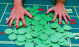 A  dealer arranges gambling chips on a baccarat table a few days before the Solaire casino-resortc opening in Pasay city, Metro Manila, the Philippines. The $1.2 billion Solaire casino-resort is the first of four projects to open before 2017, as the Philippines stries to lure gamblers and tourists to overtake Singapore and become the region's biggest casino destination.