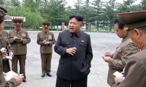 This undated photo released by KCNA on 25 May 2014 shows Kim Jong-Un visiting the Chonma Electrical Machine Plant in North Phyongan Province.