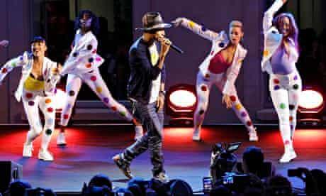 Pharrell Williams performs at GIRL exhibition, Paris