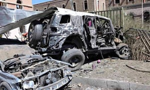 Damaged vehicles are seen at the scene of a suicide attack at the Defence Ministry compound in Sanaa