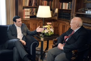 Leader of the radical left Syriza party Alexis Tsipras (L) meets with Greek president Carolos Papoulias in Athens on May 26, 2014