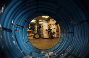 A fork lift truck driver loads water sanitation equipment at Oxfam's logistics warehouse in Bicester, England.
