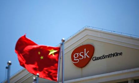 Chinese national flag in front of GlaxoSmithKline office building in Shanghai
