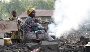 a woman and her children at a camp in DRC