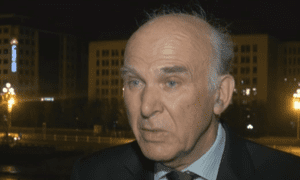 Vince Cable being interviewed in China