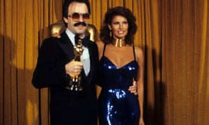 Giorgio Moroder and Raquel Welch.