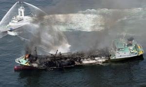 Black smoke rises from Shoko Maru