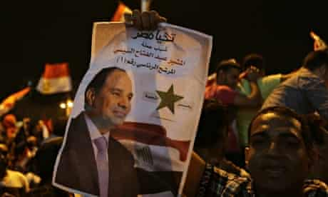 A supporter holds up a poster of Egypt's former army chief Sisi