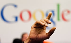 hand raised in front of Google logo