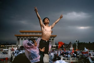 A student on hunger strike gestures on Tiananmen Square, 26 May.