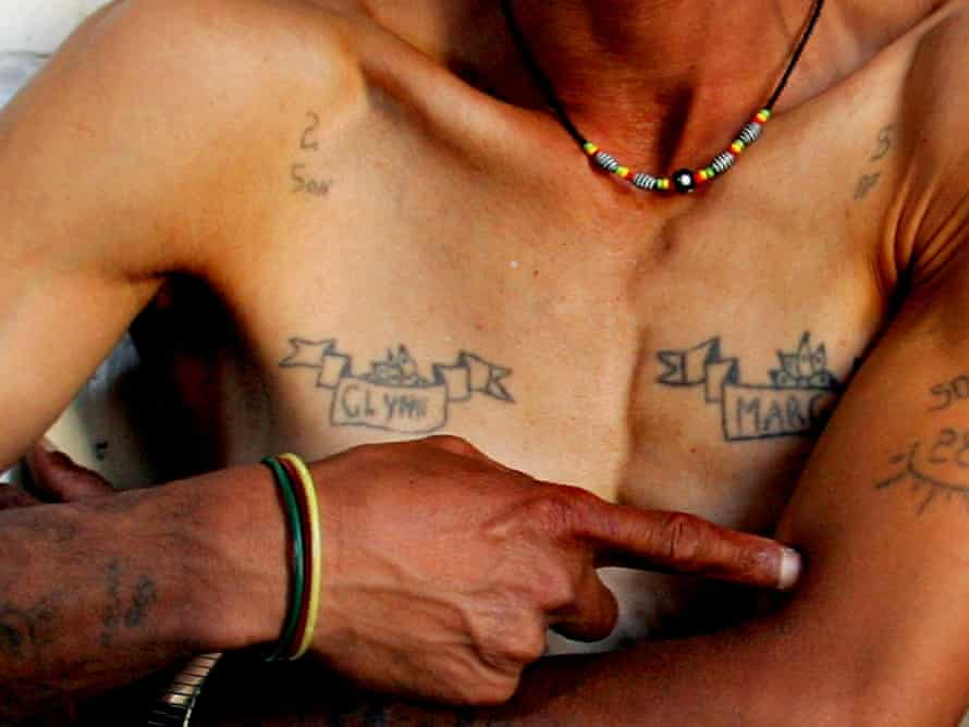 Magadien Wentzel, 45, shows his gang tattoos at his home in Mannenberg township near Cape Town. He walked away from a 25-year rise to the top echelons of the feared 28s gang.
