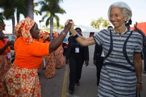 IMF Managing Director Christine Lagarde (R) being greeted by local singers as she attends the opening session of the Africa Rising Conference, on May 29, 2014 at the Chissano Conference Center in Maputo.
