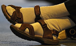 A man wearing socks and sandals