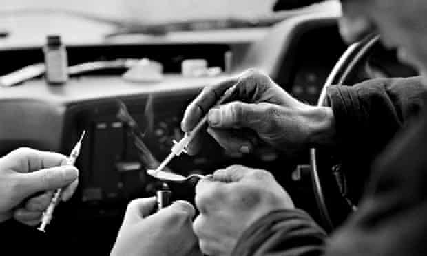 Heroin addict preparing drugs